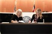 City of Fort Lupton Mayor Zo Stieber & Town of Firestone Mayor Bobbi Sindelar jointly sign the IGA.