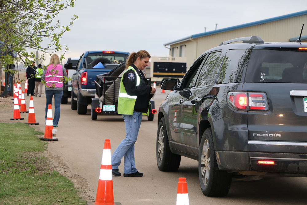 Town employees directing traffic at clean up day