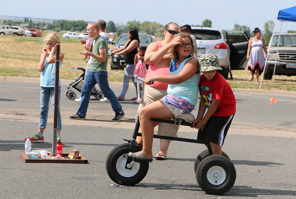 Children riding large tricycle