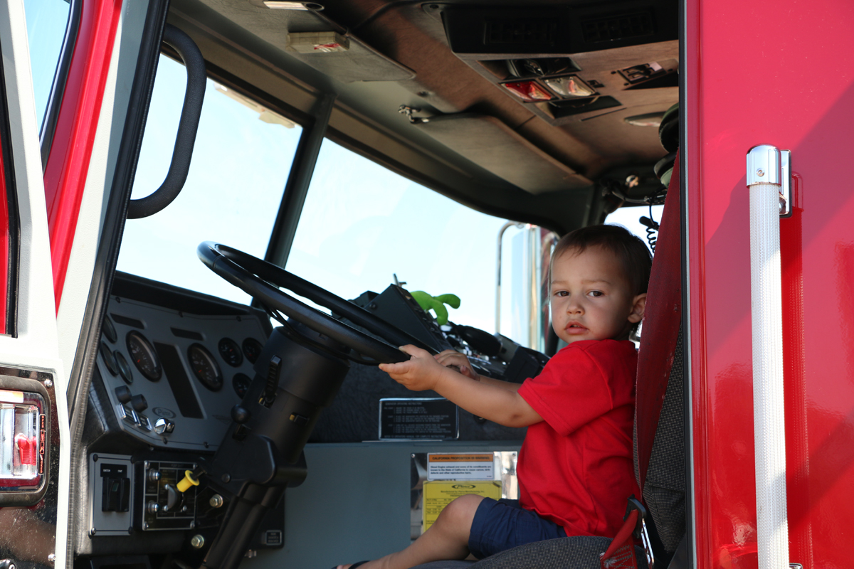 Child sitting in Fire Truck