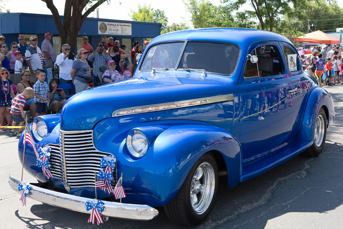 Blue classic car in 4th at Firestone parade