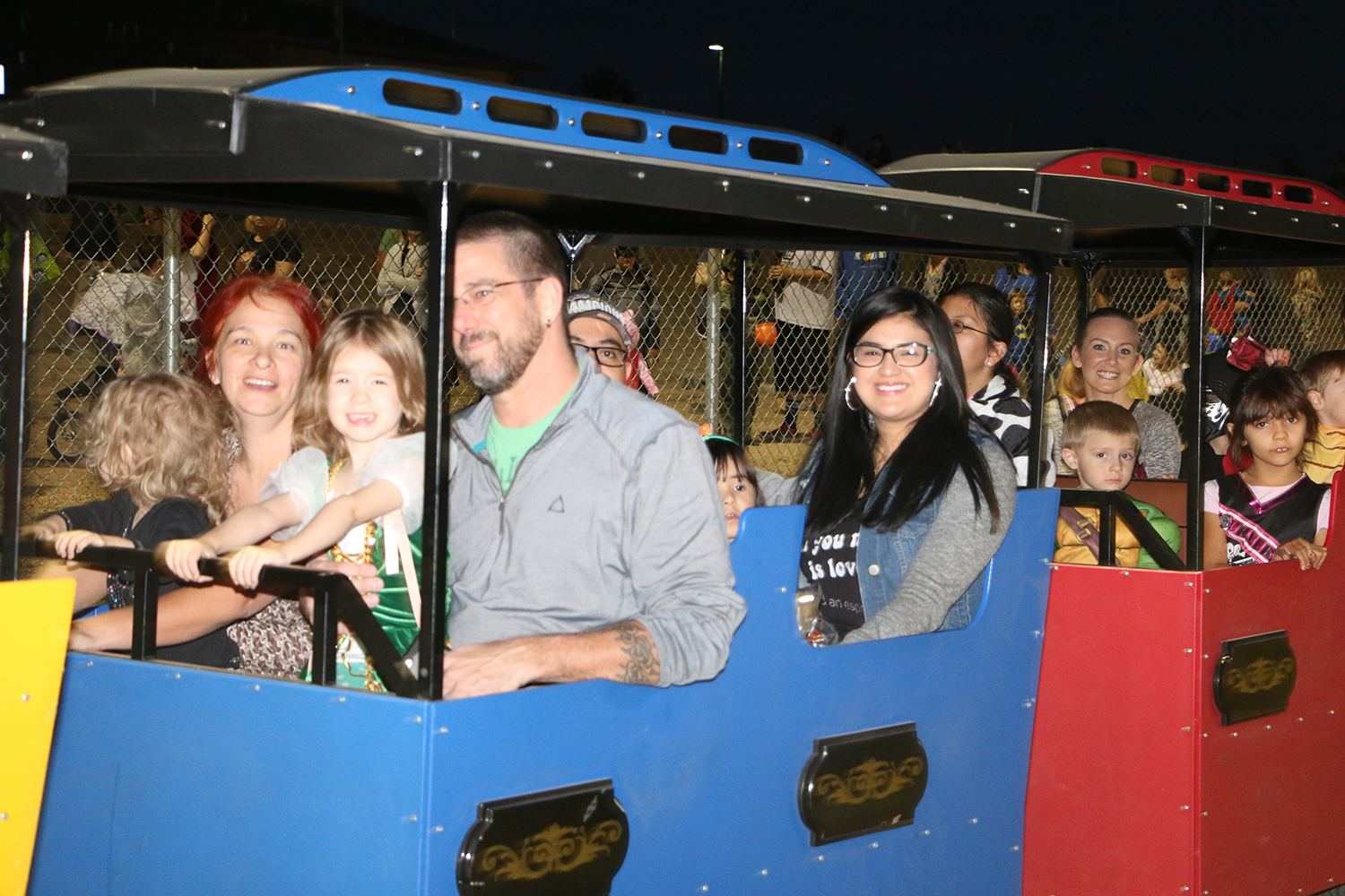 Families riding train at Halloween Safe Night