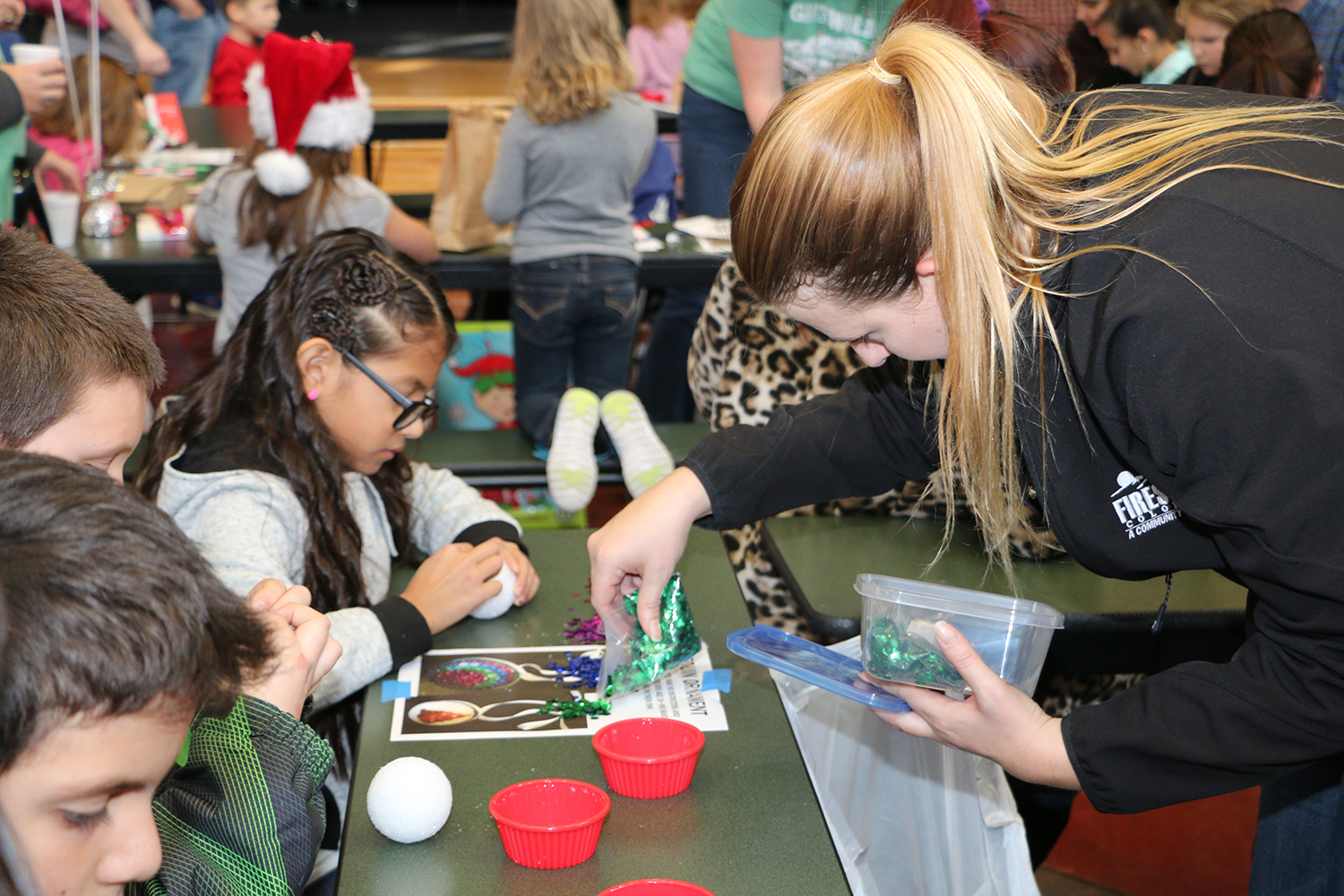 2016 Holiday Festival children doing crafts