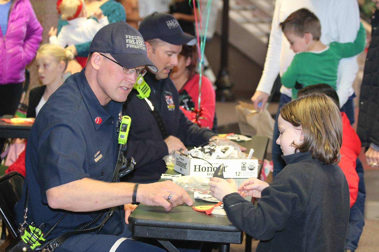 2016 Holiday Festival children doing crafts with Firefighters